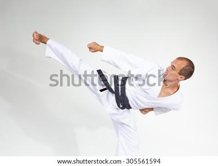 Yoko geri beats sportsman with black belt #305561594