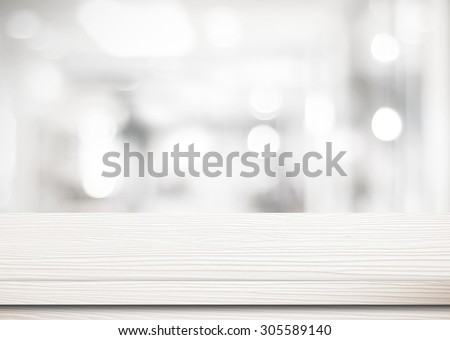 White wooden table top background over bokeh light, Empty counter surface in blur room background, White wood shelf, table  for retail shop, store product display, mock up,  template banner #305589140