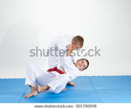 On a blue mats athletes train judo throws #305700098