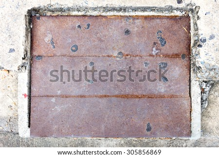 Sewer cover on concrete background used for close drain system #305856869