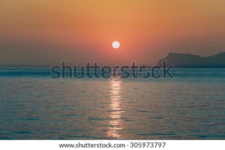 Sunset over sea #305973797