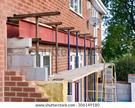 installing metal beam during house extension #306149180