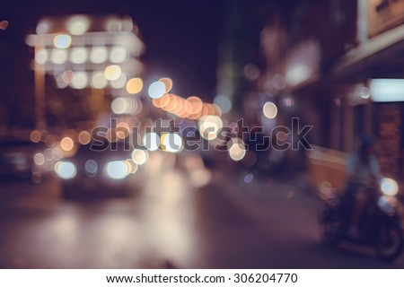 A crowd of people moving on the old town city night street defocused blurred abstract image at phuket thailand #306204770