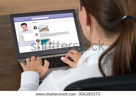 Close-up Of Businesswoman Chatting On Social Website With Laptop At Desk #306283373