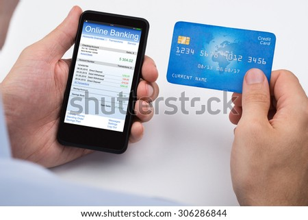 Close-up Of Person With Credit Card And Mobile Phone Doing Online Banking #306286844