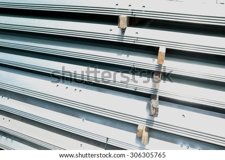 Hot-dip galvanized steel angles bunch on the rack in warehouse before shipment #306305765