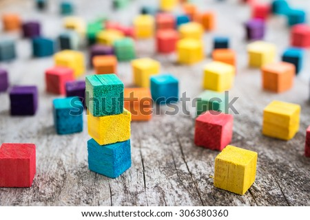 Colorful wooden building blocks. Selective focus Royalty-Free Stock Photo #306380360