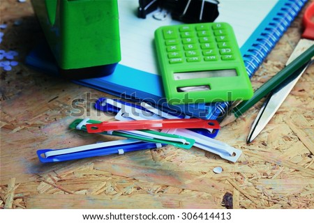 Mix book and calculator, stapler, tape, paper punch, pencil, scissors for office #306414413
