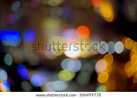 Blur image of city lights with bokeh effect at night