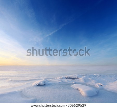 Endless frozen sea water and blue sky over horizon. Landscape at winter season Royalty-Free Stock Photo #306529529