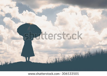 silhouette of woman holding umbrella sunny day #306533501
