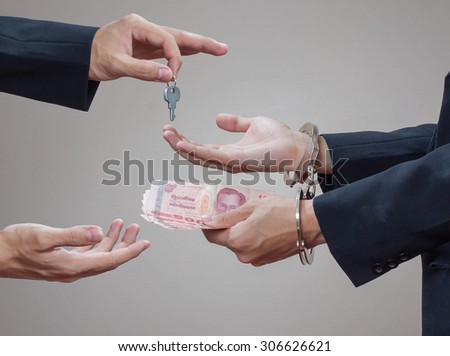 Man's hands in handcuffs and money in his palms #306626621
