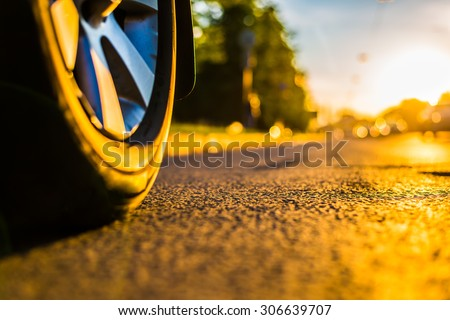 Sunny day in a city, headlights of approaching cars, the view from the road level from the wheel of the car #306639707