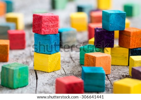Colorful wooden building blocks. Selective focus Royalty-Free Stock Photo #306641441