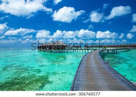 Beautiful beach with water bungalows at Maldives #306760577