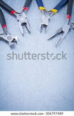 Set of electric metal nippers on scratched metallic background copyspace. #306797489