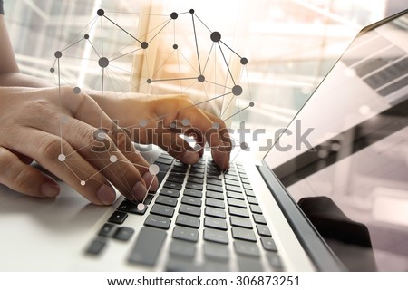 Double exposure of business man hand working on blank screen laptop computer on wooden desk as concept with social media diagram   #306873251
