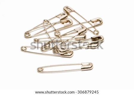 Safety pin isolated on white background.  Royalty-Free Stock Photo #306879245