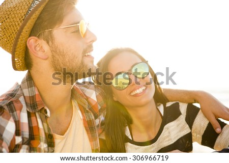 Young couple at the beach and having fun #306966719