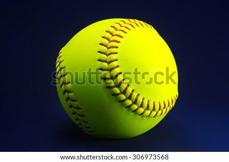 Softball on a blue background