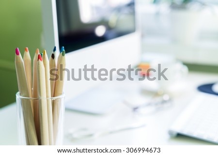 Office workplace with computer on white table. Focus on pencils #306994673