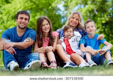 Happy parents posing with three children #307158500
