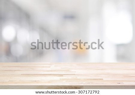 Wood table top on blurred white gray background from hallway - can be used for display or montage your products #307172792