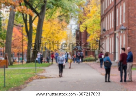 Blurred background of a university campus on a beautiful Fall day.