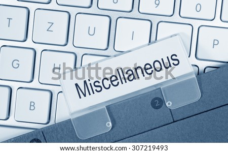 Miscellaneous - folder with text on computer keyboard in the office Royalty-Free Stock Photo #307219493
