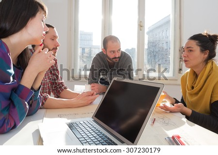 Young group of people/architects discussing business plans. #307230179