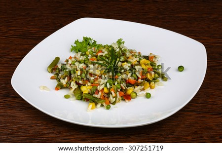 Mexican rice with wegetables, rosemary and spices #307251719