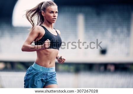 Fitness woman on stadium #307267028
