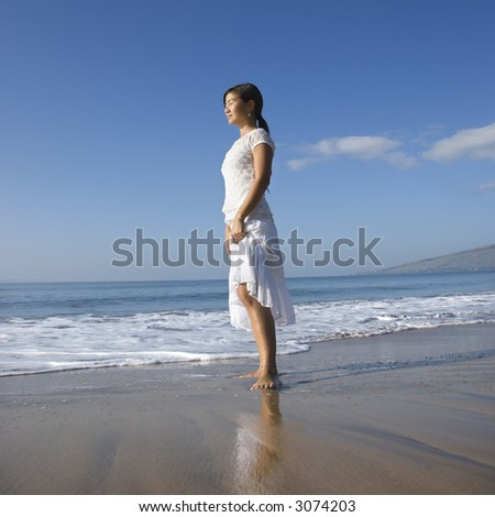 Young Asian female standing at shoreline. #3074203