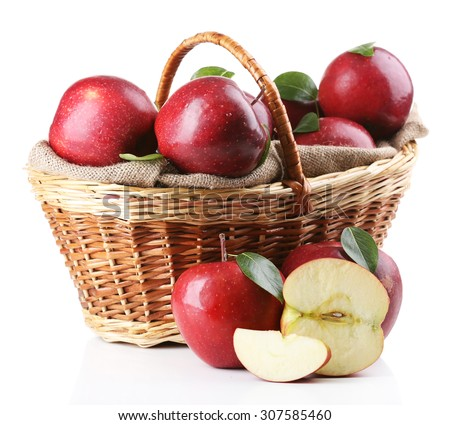 Red apples in wicker basket isolate on white #307585460