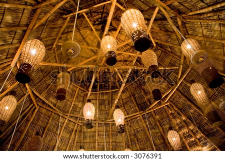 Wicker lamps dangling from the ceiling of a beach bar in El Salvador #3076391