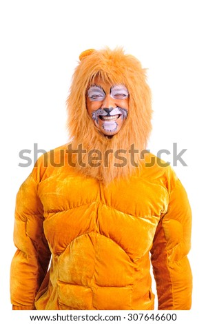 An adult man in a plush lion costume fooling around and grimace his painted face, close-up portrait, isolated #307646600