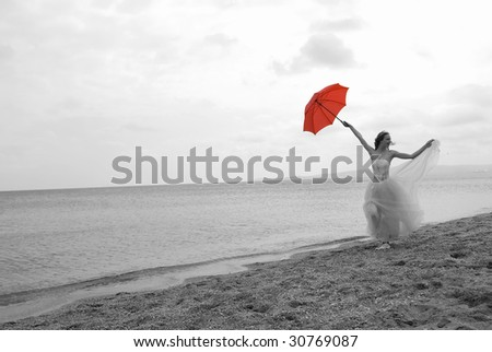 The beautiful bride with a parasol on seacoast #30769087