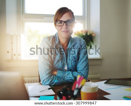 Successful business woman working at the office looking at camera #307999847