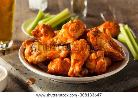 Spicy Homemade Buffalo Wings with Dip and Beer Royalty-Free Stock Photo #308133647