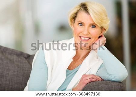 portrait of beautiful senior woman sitting indoors #308497130