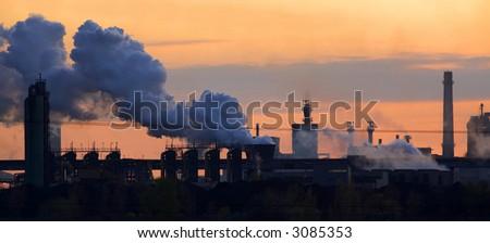 Steel mill blasting furnaces at sunset #3085353