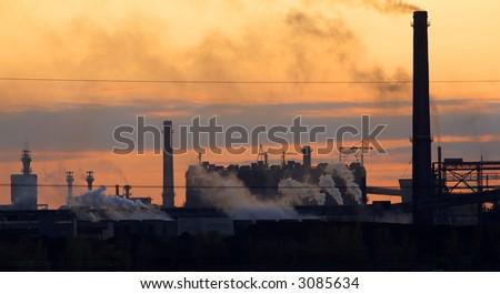steel mill blasting furnaces at sunset #3085634