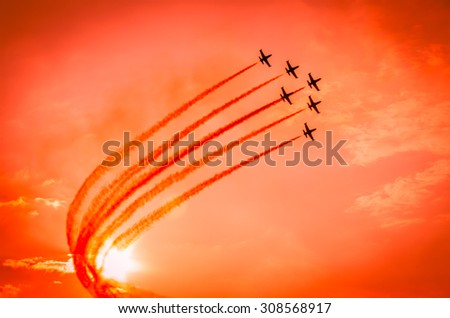 Airplanes on airshow. Aerobatic team performs flight at air show #308568917
