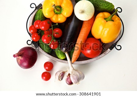 Pile of organic vegetables on a rustic wooden table #308641901