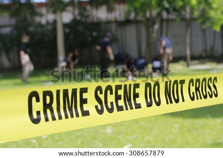 crime scene do not cross tape and blurred law enforcement and forensic background #308657879