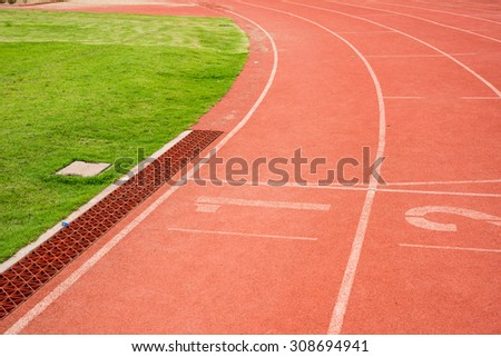 running Track Lane Numbers and grass #308694941