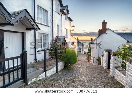 A narrow cobbled street lined with pretty cottages at Clovelly in north Devon Royalty-Free Stock Photo #308796311