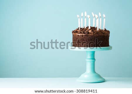 Chocolate birthday cake with candles Royalty-Free Stock Photo #308819411