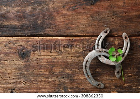 St. Patricks day. Four leaved clover and two horseshoes on wooden board #308862350