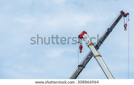 X Cross Crane working with blue sky background / Copy  Space in the Left of Picture #308866964